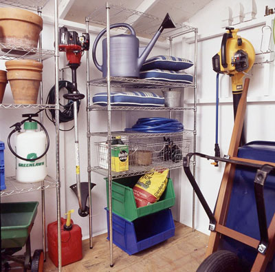 Gardening tools organized onto shelves