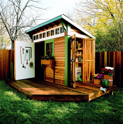 A wooden shed with a small deck